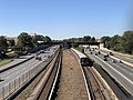 2018-10-23 12 24 56 View west along Interstate 66 and the Orange Line of the Washington Metro from the overpass for Virginia State Route 243 (Nutley Street) in Oakton, Fairfax County, Virginia.jpg