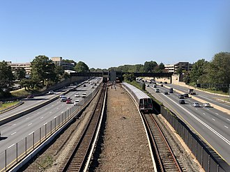 Interstate 66 - View west along I-66 in Oakton, with a Washington Metro train using the tracks in the median