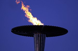 Paralympic symbols - View of the Paralympic cauldron alight in the night sky at the 2000 Summer Paralympics