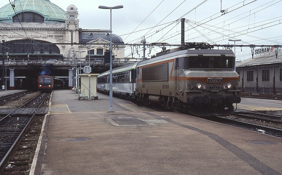 Taken on my Summer 1990 week's holiday in France, BB7393 is seen in charge of a main line train on the Paris to Toulouse classic route. Once the high speed line from Paris to Tours was completed, TGVs began to operate the longer way round via Bordeaux. Despite being a longer way round, this was quicker than the classic route which runs through more hilly terrain.  As such the route has remained important over the years with Limoges being an important junction station for several secondary routes that join up.
