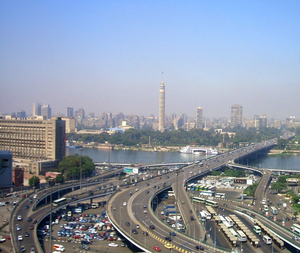 6th October Bridge - A view of a small section of the 6th October Bridge near Ramses station and Egyptian Museum, crossing Nile River to Gezira Island with Cairo Tower in background.