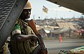 A Rwandan soldier stands guard at an airfield near a refugee camp full of displaced citizens at Bangui M'Poko International Airport in the Central African Republic Jan. 19, 2014 140119-F-RN211-664.jpg