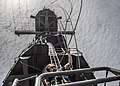A Sailor lowers lines on the aft mast of USS Essex. (20187731109).jpg