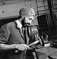 A Sikh technician working with metal tubing at the Government Training Centre, Letchworth in 1941. D5926.jpg