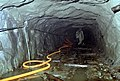 A South Korean investigation team member explores North Korean tunnel No. 4 near Kach'il-Bong Peak. South Korean counter-tunnels are being constructed to eliminate the value of Nort - DPLA - 3c9bed5f34b5f3c6393c44fc8ee07f46.jpeg