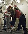 A U.S. Coast Guard fire team aboard the maritime security cutter USCGC Bertholf (WMSL 750) prepares to enter an area during a gas leak drill as part of Arctic Shield 2012 in the Arctic Ocean 120829-G-VS714-090.jpg