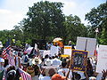 A day without immigrants - protesters, justice for janitors, flags.jpg