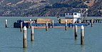 A ship in the harbour - Erskine Point in Lyttelton, New Zealand.jpg