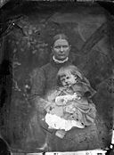 A woman with a child NLW3364739.jpg