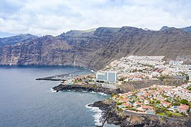 Aerial view of the steep coast of Los Gigantes on Tenerife, Spain (48225320527).jpg