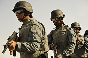 Afghan national policemen demonstrate their ta...