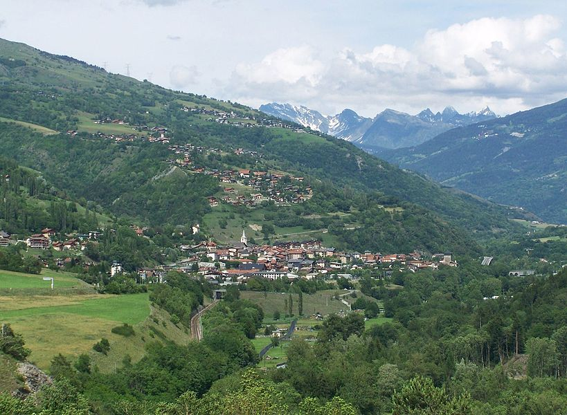 Sight of French communes of Aime (the biggest one in the center) and La Côte d'Aime (village seen above) in Savoie, France.