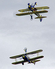 The UK Utterly Butterly display team flying Boeing Stearman PT-17 biplanes at an English airshow