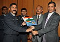 Air Marshal J.N. Burma, Air Officer in Charge Administration hands over the Indian Tricolour and IAF flag to Wing Commander RC Tripathi, leader of 'Mission Seven Summits', in New Delhi on February 10, 2010.jpg