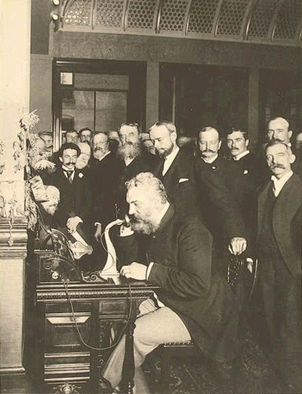 Bell at the opening of the long-distance line from New York to Chicago in 1892 Alexander Graham Telephone in Newyork.jpg