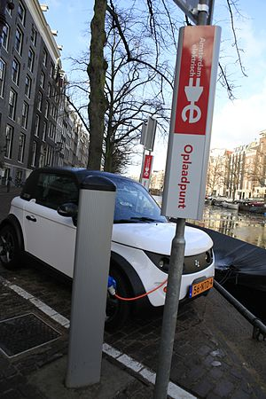 Electric vehicle network - Charging station along a canal in Amsterdam