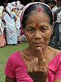 An elderly voter showing the ink mark on her finger after casting her vote, at a polling booth of the Madhupur Dewri Gaon, for the 1st phase of Assembly Election, in Assam on April 04, 2011.jpg