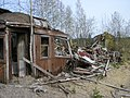 An old, wrecked railway carriage in the middle of a gravel pit (05-2007) - panoramio - pan-opticon.jpg