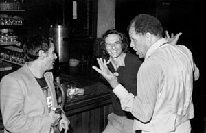 Jack Hirschman - Saxophonists Art Pepper (left) and Dexter Gordon (right) chat with North Beach poet Jack Hirschman (center) at the bar of jazz club Keystone Korner, San Francisco (October 31, 1981)