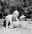 As part of the 'Holiday at Home' scheme, a young boy puts the finishing touches to the sand castle he is building in the sunshine in Regent's Park, London, 1943. D15957.jpg