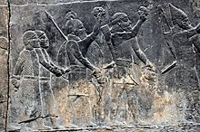 A relief showing Assyrian soldiers and their prisoners