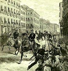 Grabado de la época que reproduce el momento en que el obrero anarquista Juan Oliva Moncasidispara contra el reyAlfonso XII de Españael 25 de octubre de 1878.