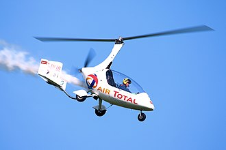 Autogyro - A modern, closed-cabin, pusher-propeller autogyro in flight