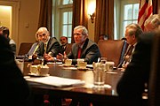 Flanked by Michael Chertoff, Secretary of Homeland Security, left, and Secretary of Defense Donald Rumsfeld, President George W. Bush meets with members of the White House Task Force on Hurricane Katrina Recovery on August 31, 2005, in the Cabinet Room of the White House.