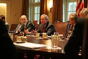 Hurricane Katrina - Flanked by Michael Chertoff, Secretary of Homeland Security, left, and Secretary of Defense Donald Rumsfeld, President George W. Bush meets with members of the White House Task Force on Hurricane Katrina Recovery on August 31, 2005, in the Cabinet Room of the White House.