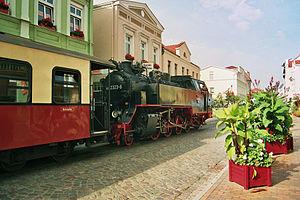 "Street running - A ""Mollibahn"" train running through Bad Doberan, Germany"