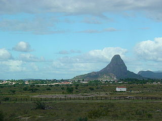 Inselberg Isolated rock hill or small mountain that rises abruptly from a relatively flat surrounding plain