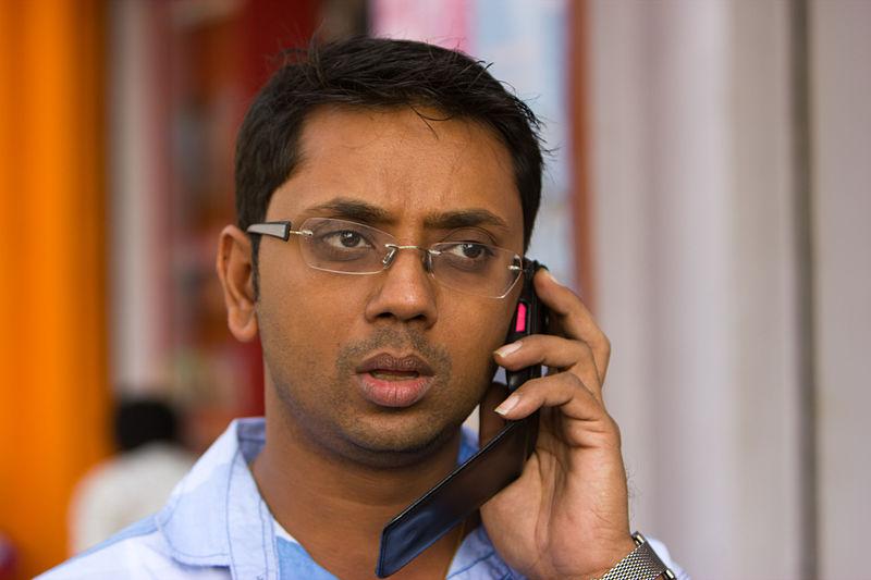 File:Bangalore Bike guy on phone November 2011 -42.jpg