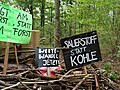 Barrier with protest-signs in the Hambach forest 08.jpg