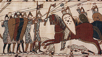 Godred Crovan - A depiction of English infantry and Norman cavalry on the eleventh-century Bayeux Tapestry. In the course of his career, Godred appears to have battled both Anglo-Saxon and Anglo-Norman forces. The depicted infantry are shown formed in a shield wall, a tactic employed by the Norwegian-backed forces at Stamford Bridge.