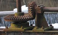 Bevel gear used to lift floodgate by means of central screw.