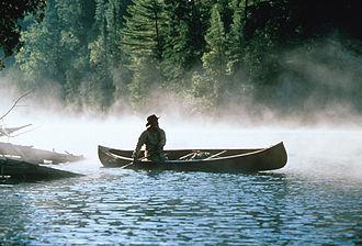 Bill Mason - Bill Mason in a canoe.