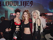 Three young women, dressed as vampires