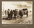 Boche prisoners assist in bringing in Australian wounded (3007145613).jpg