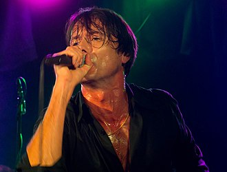 Brett Anderson - Brett Anderson on stage with Suede in Manchester 2011.