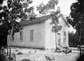 Brogden School, Wayne County, NC; ca 1900-1905. Pictured is a rural frame one-room school house. A handwritten ID label is affixed to the mounting card. Brogden Township and community are located in (19090643905).jpg