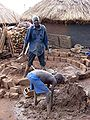 Building hut in Kitgum IDP camp, Uganda.jpg