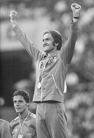 Athletics at the 1980 Summer Olympics – Men's marathon - Waldemar Cierpinski, celebrating his gold medal. Left behind him Gerard Nijboer