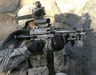 A soldier from the 1st Infantry Regiment provides security for a joint Army-Marine patrol in Rawa in 2006. The shoulder sleeve insignia has the logo of the 2nd Marine Division. CSA-2006-01-12-095303 M249SAW.jpg