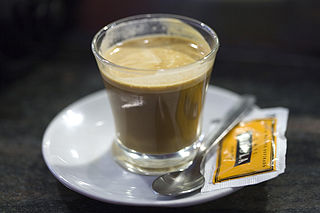 beverage consisting of espresso mixed with a roughly equal amount of warm milk to reduce the acidity