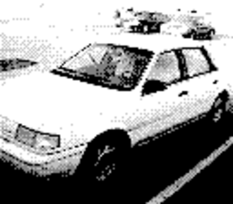 Game Boy Camera - A picture of a Ford Tempo taken with the Game Boy Camera