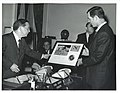 Carl Albert and an unidentified man looking at Apollo 16 plaque in Speaker's office.jpg