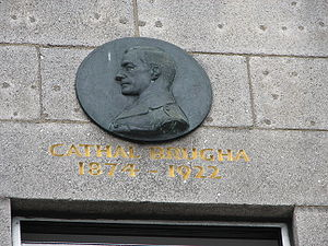 Cathal Brugha - Cathal Brugha commemorative plaque in O'Connell Street, Dublin. (Bullet marked stonework included as part of memorial)