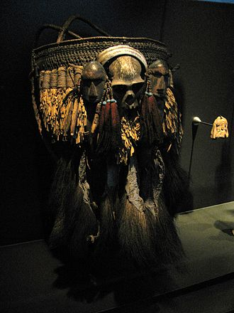 Konyak people - A ceremonial basket of the Konyak tribe with a skull and two human heads carved from wood. This basket is a status symbol.