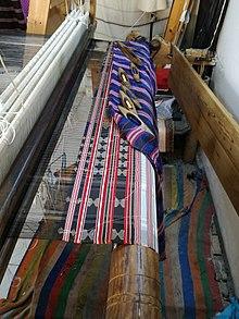 Ceremonial fabric in a weaving Workshop of Mahdia.jpg