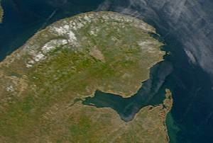 Chaleur Bay - Satellite image of Chaleur Bay (NASA). Chaleur Bay is the large bay in the centre of the image; the Gaspé Peninsula is to the north and the Gulf of St. Lawrence is seen to the east.